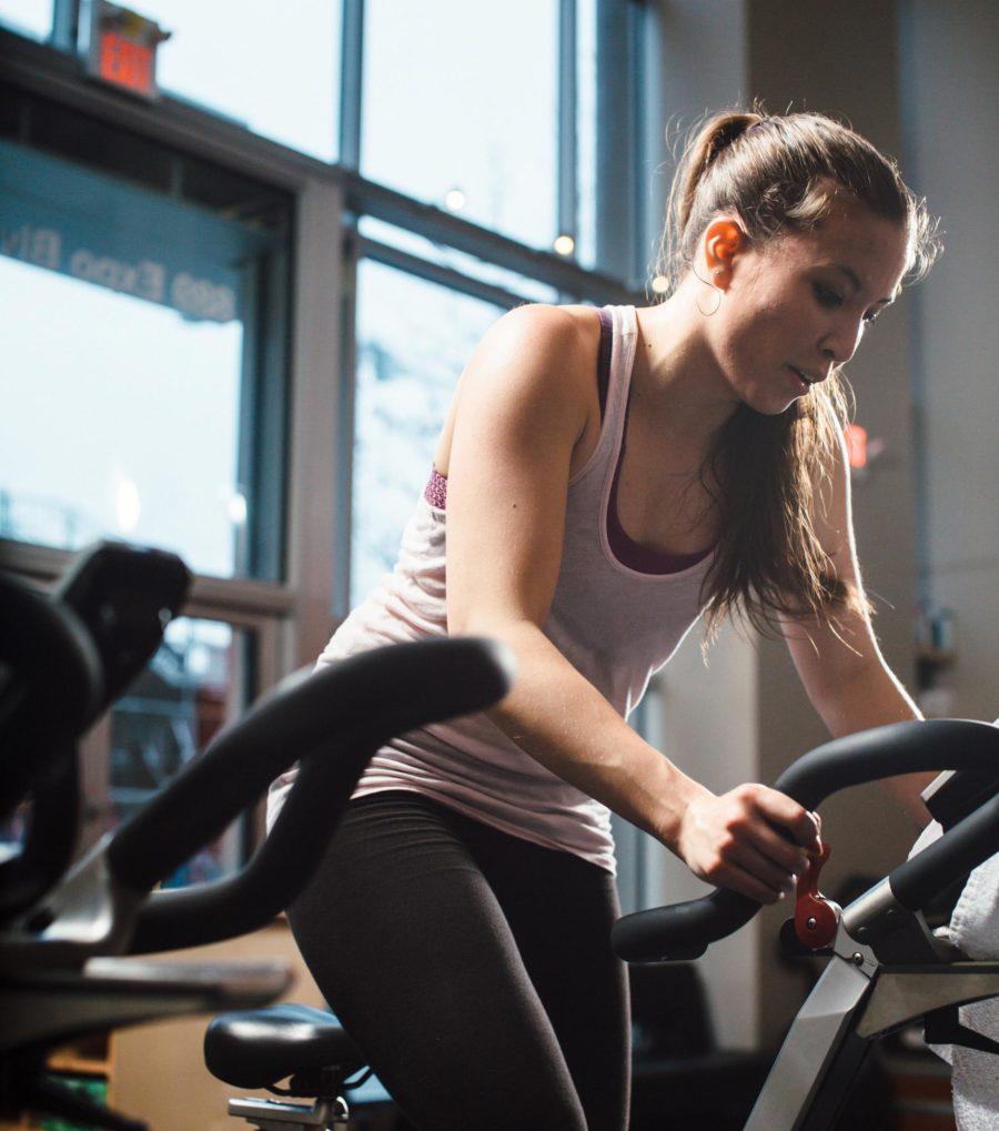 woman on workout bike at 50 Jones Apartments