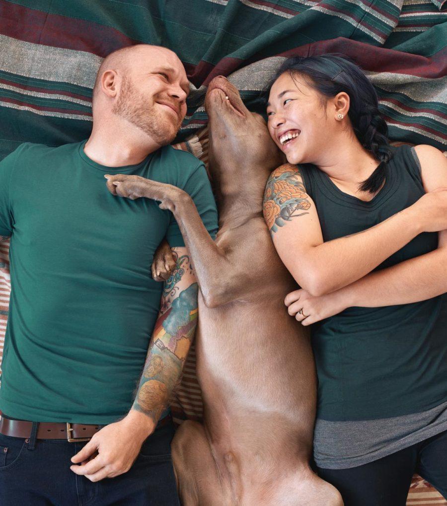 Couple with dog on blanket